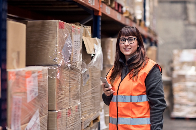 Portrait of a woman working in the warehouse